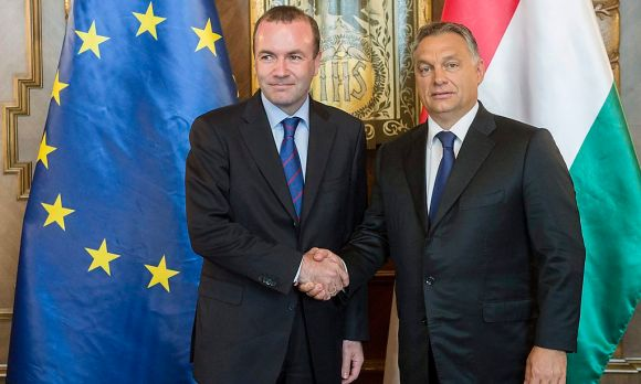 epa04925037 Hungarian Prime Minister Viktor Orban (R) shakes hands with Chairman of the European People's Party (EPP) group of the European Parliament Manfred Weber during their meeting in the Parliament building in Budapest, Hungary, 11 September 2015.  EPA/SZILARD KOSZTICSAK HUNGARY OUT