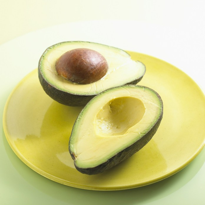 Avocado on a yellow plate