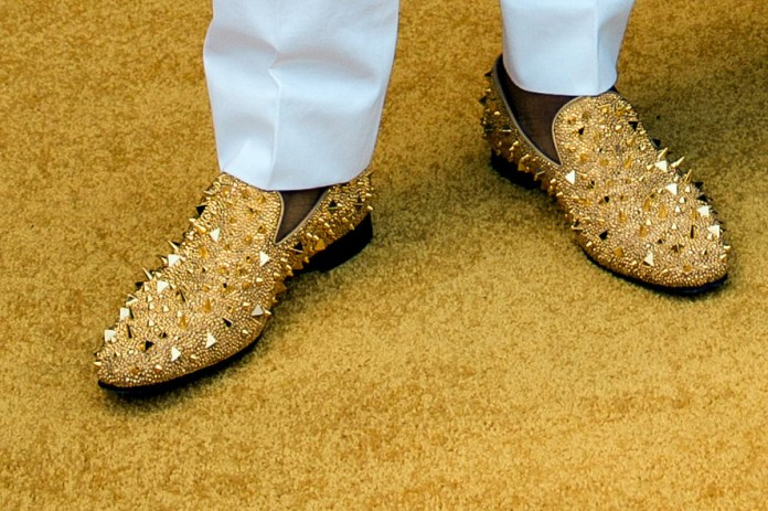 Taylor Glascock photograph of Dante Fowler Jr wearing Christian Louboutin gold spiked loafers