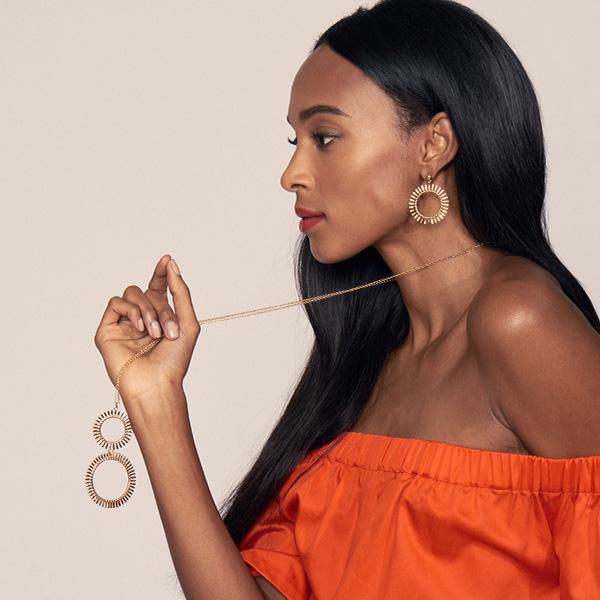 Lele Sadoughi Hula Hoop Pendant necklace and earrings