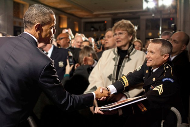 Obama shakes hands with Ingram