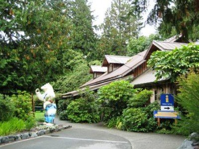 Lovely gardens and artwork surround the Sooke Visitor Centre/Museum/Art Gallery - cycling in Sooke