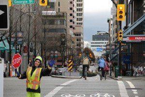 Some friendly flag people were roped in to help out on the new Hornby Separated Bike Lane  - Vancouver Cycling Culture