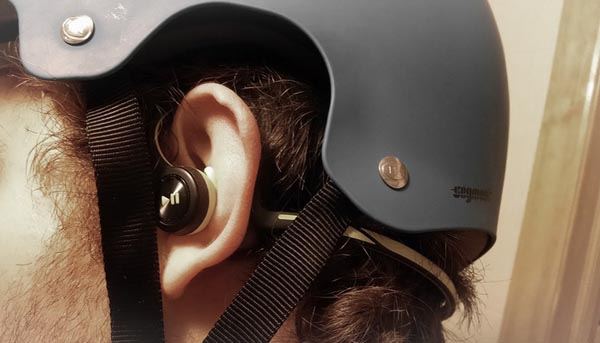 Notice how neatly the Plantronics headphones fit under a helmet. Best Bluetooth headphones for cyclists - Plantronics Backbeat FIT Bluetooth headphones review