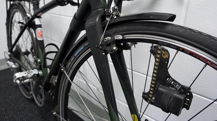 I always add at least one Monkeylectric light to my commuter bikes - they light up in bright patterns, making you super visible from the side. They have saved me more than once on a dark morning from sleepy motorists coming out of side roads