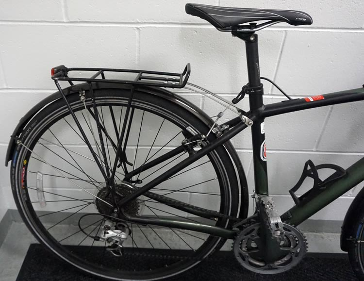 """How to set up a commuter bike. I have literally never heard anyone say, """"Rats – my bike rack wore out!"""" So, a decent bike rack is totally worth the investment. This is my own commuter bike, a Specialized TriCross, equipped with rack, wrap-around fender, and rear light. Ready to ride!"""