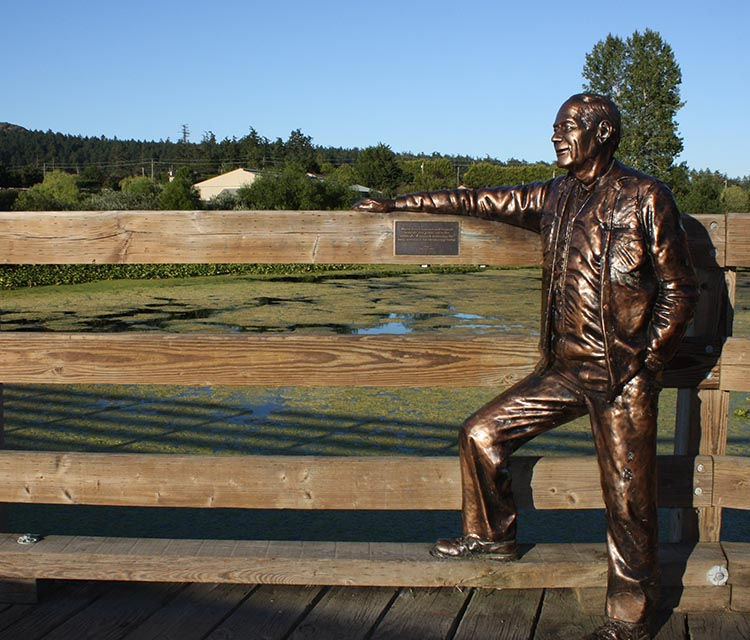 """Life-size statue on this pedestrian bridge on the Lochside Trail, called """"Roy"""" - if anyone knows more about this artwork, and who """"Roy"""" was, please let me know."""