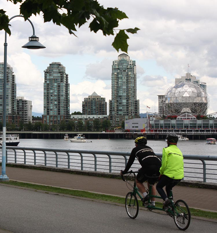 Give your relationship a test - see if it can survive a ride on a bicycle made for two - personally I am never going to risk it, but many people do! Here's a couple on the Seaside Bike Route, with the iconic globe of Science World in the background