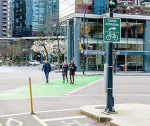 Pedestrians in bike lane in Vancouver - (Photo by David Roos - click on the photo to see David's photo essay on the challenges of cycling to work in Vancouver)