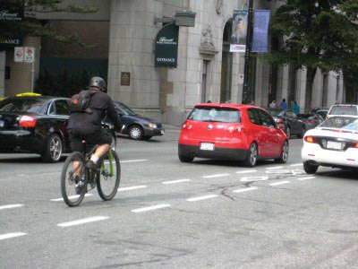 If a lane is full of cars, is it still a BIKE lane? Cyclists on Hornby bike right next to cars. At rush hour this becomes dangerous, especially approaching Georgia, where cars cut across the cycling lane to turn right.