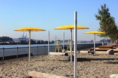 """New West Pier Park at the end of the Central Valley Greenway even has a """"beach"""" with beach sand, umbrellas and hammocks!"""