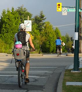 child on back of bike