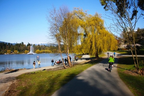Biking past Lost Lagoon along the Stanley Park Seawall Bike trail, Vancouver. That's my child in the green sweater!