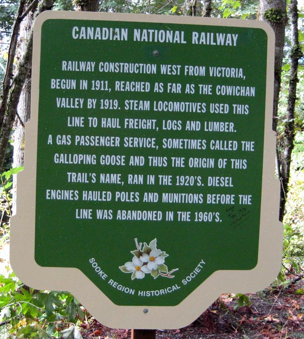 A sign on the Galloping Goose Trail informs you about the origins of the trail