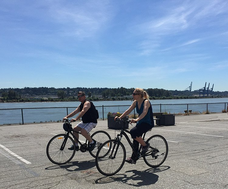 Feel the river breeze in your hair as you cycle along in safety at the New Westminster Quay