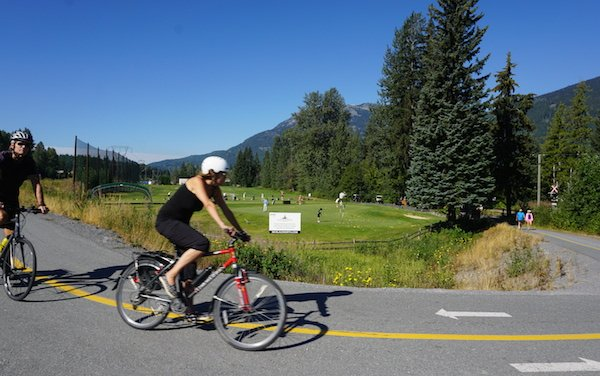Cycling past a practice golf range - part of the Nicklaus North golf course - Whistler Valley Trail – Whistler Village to Green Lake