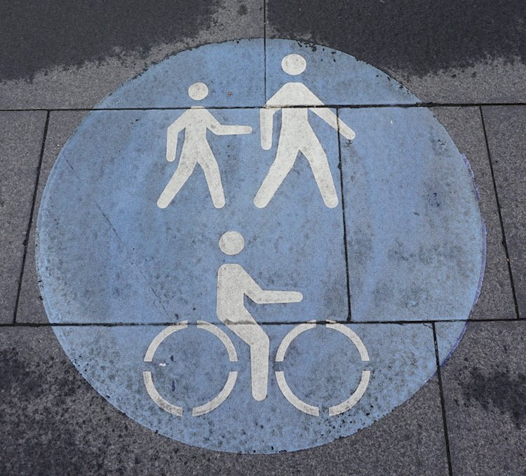Signage on Sydney sidewalks often indicates that cyclists and pedestrians can share the sidewalks