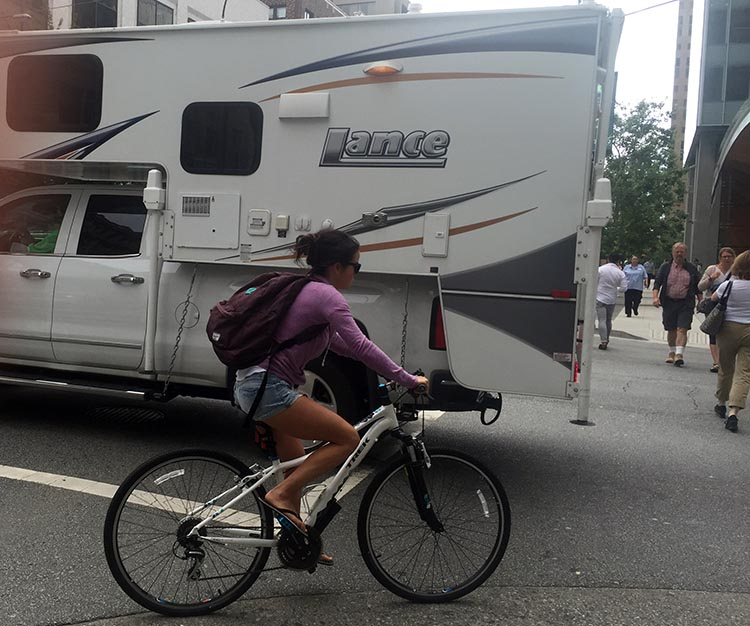 There are obvious drawbacks to immersive headphones for cyclists. Considering how vulnerable you are in flip flop on a 20 pound bike, next to large vehicles with drivers who are often oblivious of you - it really is best for cyclists to be as aware of their surroundings as possible.