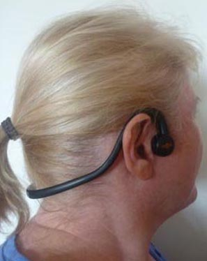 Maggie models the Trekz Aftershokz Sportz headphones