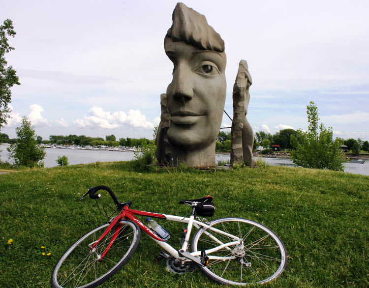Beautiful art installations decorate the Lachine Canal bike route. Here's my favorite, with my rented Norco in front of it