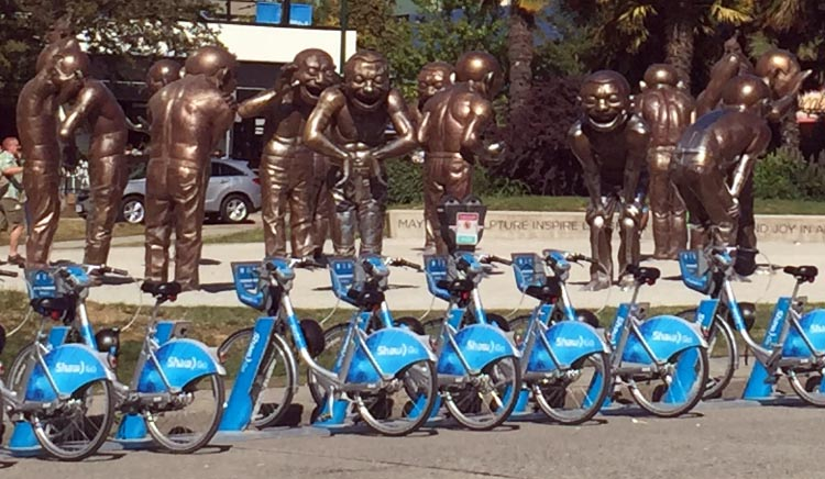 Right in front of the A-Maze-ing Laughter sculpture is a station for Vancouver's much awaited bike share program, now branded by corporate partner Shaw.