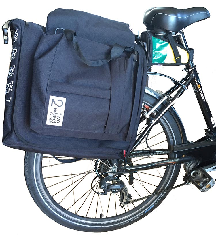 Maggie's Two Wheel Gear Garment Pannier fits well onto her European design bike. It fits onto standard and not-so-standard bike racks