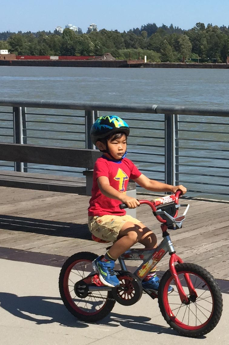 I spotted this little guy cycling on the New Westminster Quay with great speed, determination, skill and tenacity. A future Canadian Tour de France contender? New Westminster Quay is a great place for kids to develop their cycling skills! New Westminster cycling