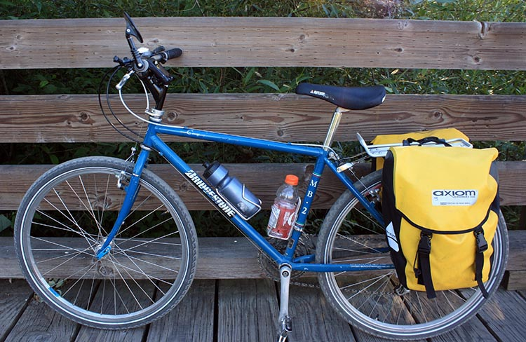 This is an example of a mountain bike with no shocks. his is the Bridgestone MB2 mountain bike. It was the first true mountain bike, and is still great today. Designed by the legendary Grant Petersen, this bike has all the key design features of a mountain bike, and provides a comfortable ride on trails, even without any suspension – just through great design. This Bridgestone design remains the standard for rigid frame mountain bikes