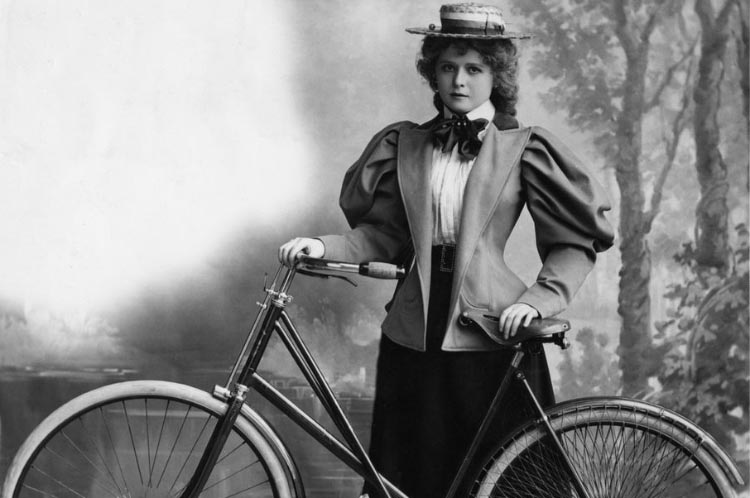 """How the Bicycle Became a Symbol for Women's Emancipation. Women were cautioned against developing """"bicycle face"""" - a tired, haggard, dust-encrusted visage that would make them seem undesirable to prospective suitors. This woman rider from 1895 apparently avoided this dire fate. Hulton Archive/Getty Images"""
