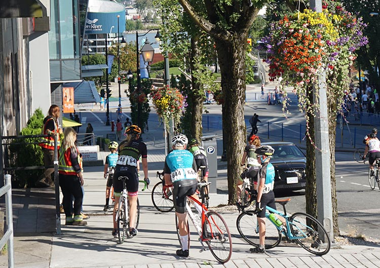 Several of the Youth cyclists converged to donate their water bottles, and the volunteers were soon able to extinguish the fire! New Westminster Grand Prix a huge success