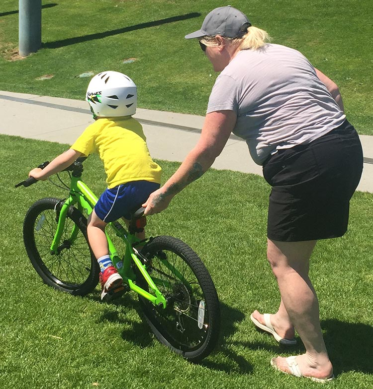 8 Steps to Teach a Child to Ride a Bike. Take hold of the back of the saddle and walk or run with the child. How to teach a child to ride a bike
