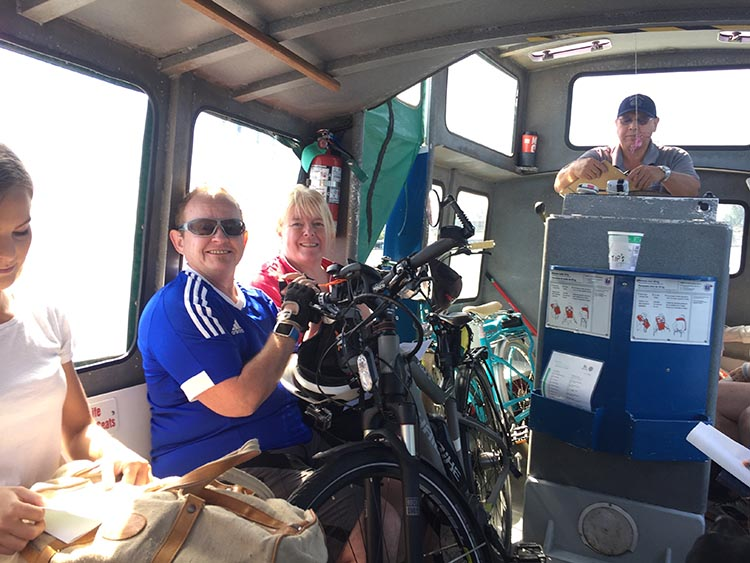 Here is a photo of Maggie and I, squished in underneath our bikes on the ferry!
