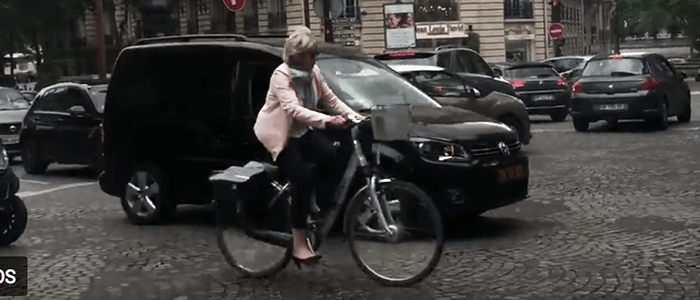 Almost no adults wear bike helmets in Paris. We were impressed by this women's heels!