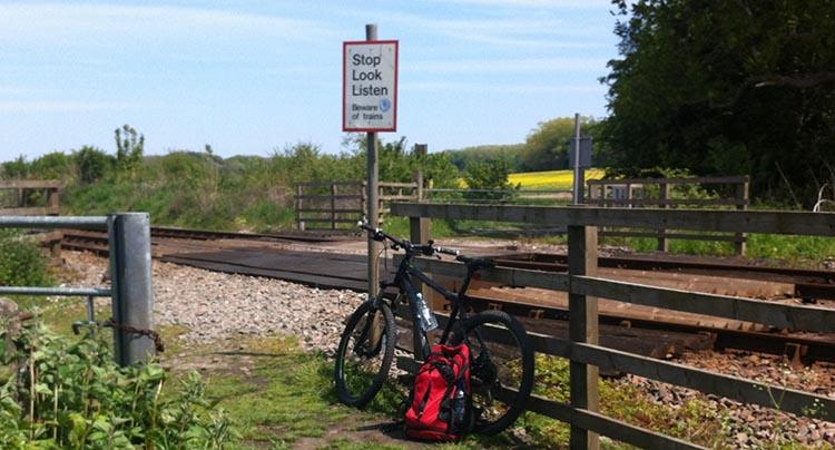 The Way of the Roses – Cycling Coast to Coast Across England bike next to railway tracks