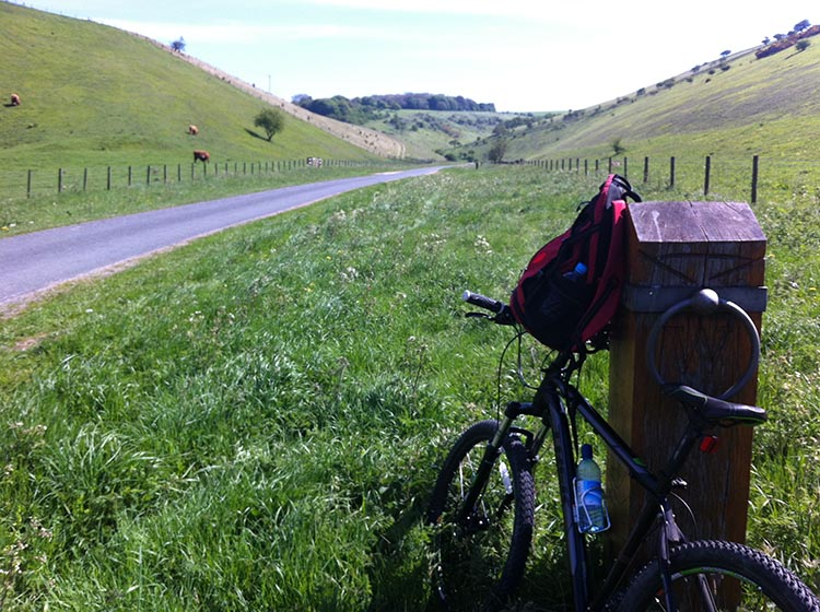 The Way of the Roses – Cycling Coast to Coast Across England bike on side of road