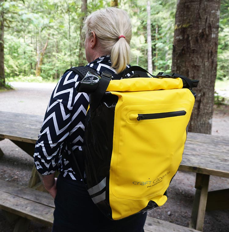 Here is Maggie wearing the Craft Cadence cycling backpack