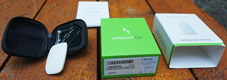 Review of Upright Go Posture Trainer and Corrector. This is the entire kit that you get with your Upright Go. It includes the Upright Go unit (which looks like a small white computer mouse), a charging cord, and a small carrying case