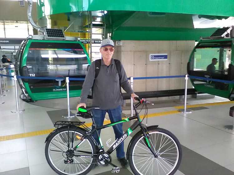 Mark Cramer in a station at the La Paz, Bolivia, aerial cable car public transportation system, called Teleférico. Cyclists are allowed to take bikes into these cabins, using their bikes part-way in a commute to get over the most hilly part by blending with public transit