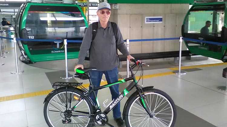 Mark Cramer in a station at the La Paz aerial cable car public transportation system, called Teleférico. Cyclists are allowed to take bikes into these cabins, using their bikes part-way in a mute to get over the most hilly part by blending with public transit