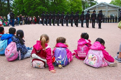 Princesses at the palace watching the changing of the guard. So cute!