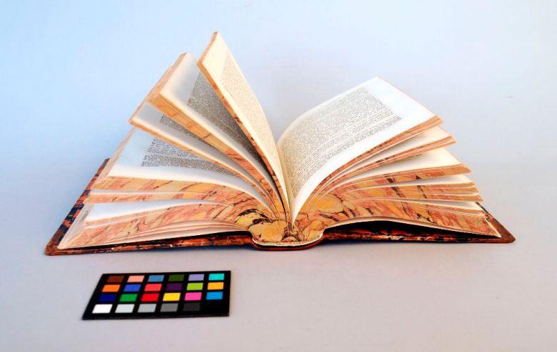 A binding open flat to show repaired textblock split