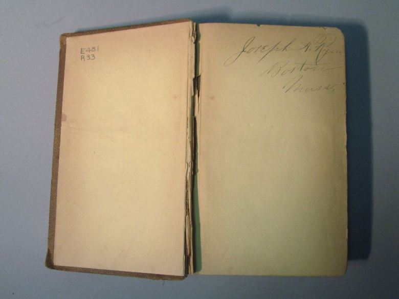 Binding with yellow endpapers, showing partially detached board