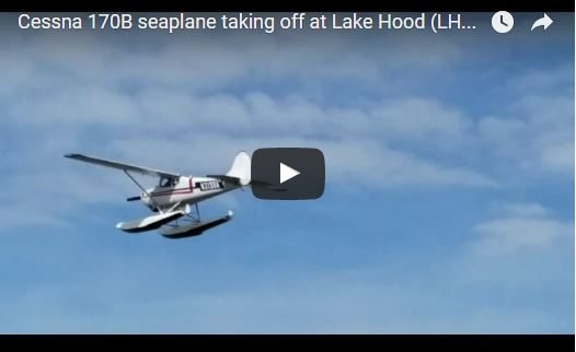 Cessna 170B seaplane taking off at Lake Hood (LHD) Anchorage AK