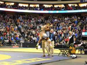 Apple Valley's Mark Hall hugs coach Jamel Tidwell after winning his sixth state title