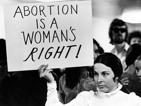 A young woman holds a sign demanding a woman's right to abortion at a demonstration to protest the closing of a Madison abortion clinic in Madison, Wis., April 20, 1971. The Midwest Medical Center was closed after authorities said more than 900 abortions had been performed at the facility in violation of the state's abortion laws. The protest is held at the Dade County building. (AP Photo)