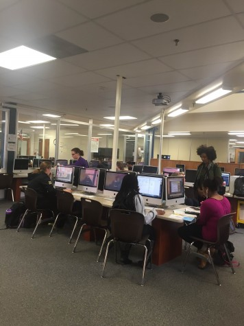 Students in the media center using the computers