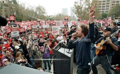 Members of Rage Against The Machine perform at a strike by the Writers Guild of America