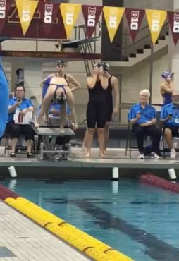 Vivien Duong prepares to dive off the block