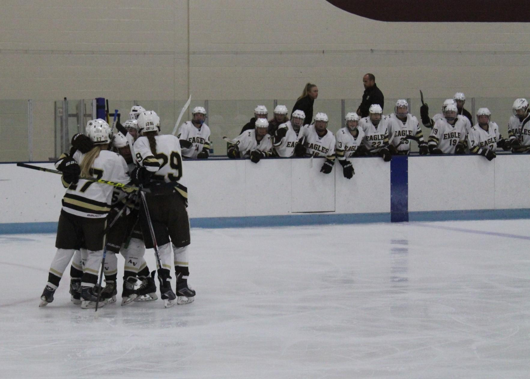 Team celebrating after tying goal.