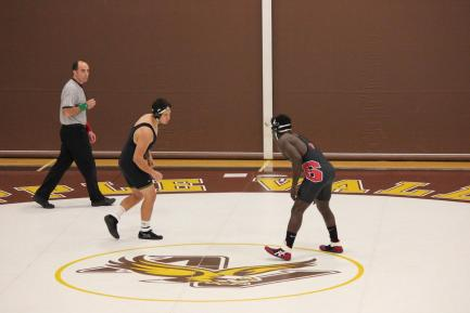 Tyler Kim and Abe Ngaima (right) face off at 195.